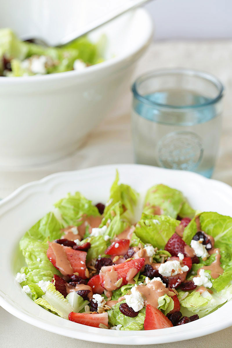 Strawberry salad recipe with goat cheese, cranberries, and seeds