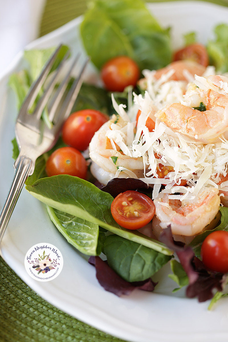 shrimp salad with cherry tomatoes and parmesan cheese